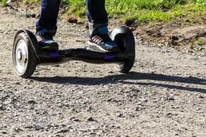 Adult riding an all terrain hoverboard