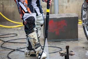 pressure washer cleaning motocross boot